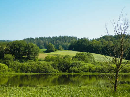Small lake in Wiezyca. Amazing nature of Kashubian Region, Northern Poland. Travel and nature concept.