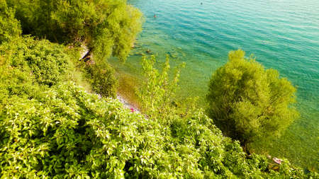 Coastal area of Ochrid Lake, Macedonia. Beautiful blue, transparent water of the oldest lake in Europe. Travel and nature concept.