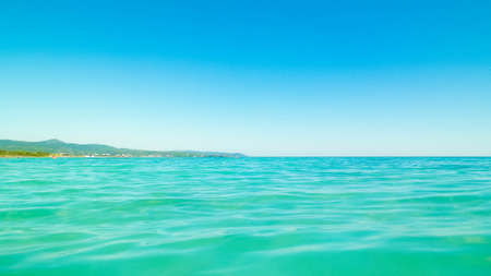 Sea coast in Vada, Tuscany, Italy. Mediterranean nature in summer day, blue, Tyrrhenian sea water on blue sky background. Vacations and nature concept. Copy space. 版權商用圖片