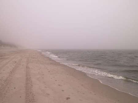 Coastal area at cold, foggy day in Lazy. Stormy weather on Baltic sea coast, Northern Poland. 版權商用圖片
