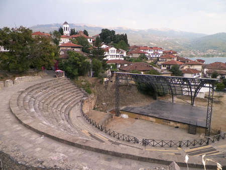 Old town in Ochrid City, amphitheater and water of Ochrid Lake as background. Architecture and tourism concept.