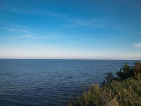 View from cliff on Baltic Sea. Copy space on blue sky. 版權商用圖片