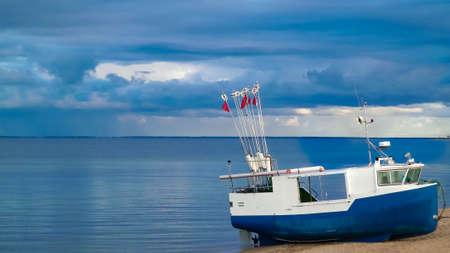 Fishing boat on a Baltic Sea coast in Mechelinki, Poland. Mechelinki is small fisherman's village in poland. Copy Space on cloudy sky. 版權商用圖片