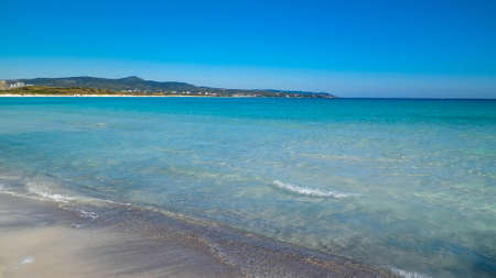 Coast and beach in Vada, Italy. Transparent, turquoise water and white sand. Travel and nature concept. 版權商用圖片
