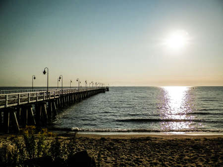 Sunrise over pier in Gdynia, Poland. Beautiful polish nature, baltic sea and summer concept. 版權商用圖片