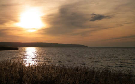 Beautiful view of sunrise over Vistula Lagoon. Coast close Frombork City.