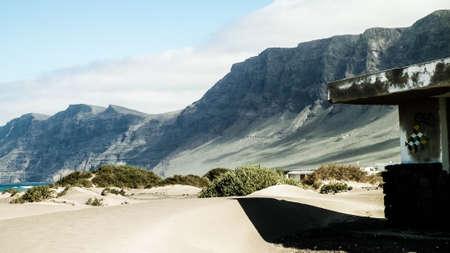 Abandoned building on beach in Caleta de Famara, Lanzarote Canary Islands. Beach in Caleta de Famara is very popular among surfers. 版權商用圖片