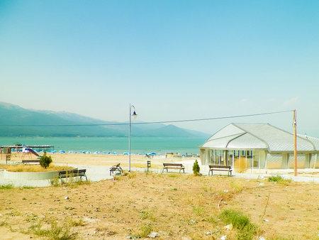Sandy beach of Prespa Lake, Macedonia. Tourism and nature concept.