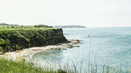 Cliffs on the Black Sea coas. Landscape of cliffs and beach in Vama Veche, Romania. Nature and traveling concept. 版權商用圖片