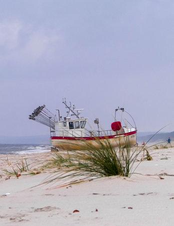 Boat on baltic sea shore in winter. Krynica, Piaski close to the Russian border Poland