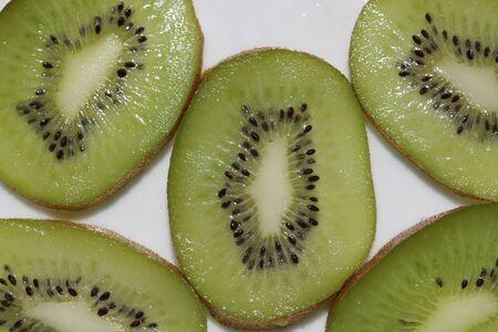 Kiwi cut by segments. Macro Stock Photo