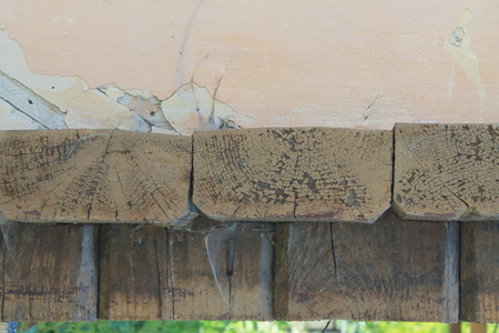 Outward ancient wooden blockhouse wall fragment with corner wall junction. Stock Photo