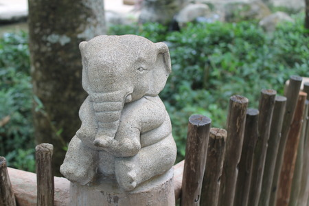 Stone elephant statue on nature background, front view. Singapore
