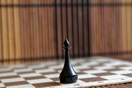Wooden chess Board and plastic chess king, on board Stock Photo
