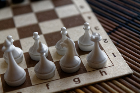 Wooden Chess Board and steel chess pieces, isolated on board 写真素材