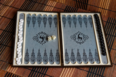 Backgammon opened, mini table game for journey