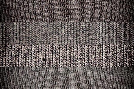 Dark background from a textile material with wicker, close-up fabric texture.