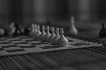 Monochrome Wooden Chess Board and steel chess pieces, isolated on board. 写真素材