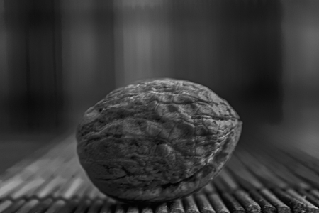 Monochrome Walnut lie on a wooden bamboo table, background for web site or mobile devices. Stock fotó