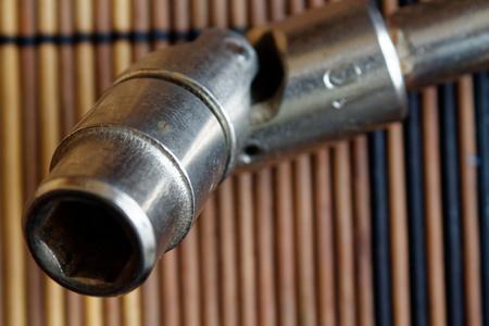 Fastener for Torx Socket for spanner on wooden background Stock Photo