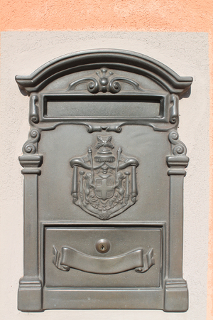 Old letterbox at a historic facade Stock Photo