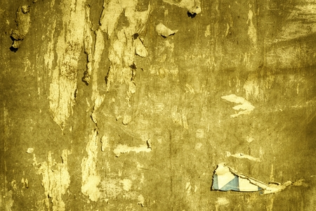 Ultra yellow Torn poster after vote on tin textured wall Ripped newspaper Imagens