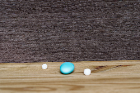 Pile of blue stones on wooden table, sample for postcard or greeting card.