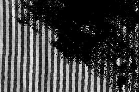 Grunge dirty Black and white closeup of stripped fabric texture. Фото со стока