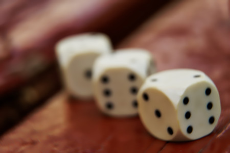 Close-up dice with defocused background, chance for winning.