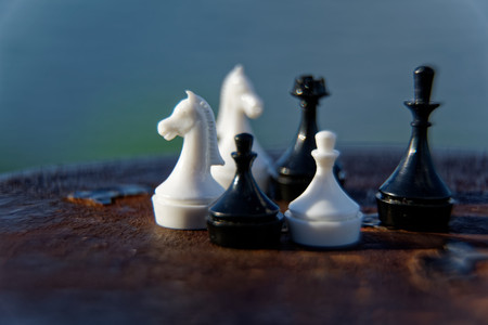 Macro chess pieces in motion with defocused background. Stock fotó