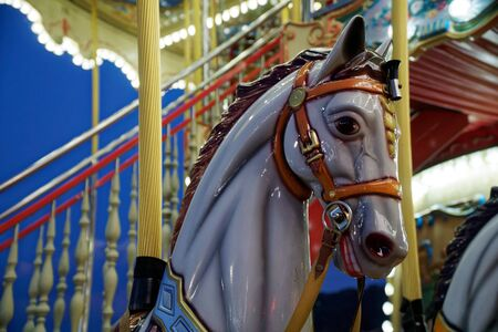 Carousel with horse and colorful lights, festival leisure