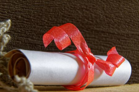 Rolled Kraft decorative paper, grunge page with red band.