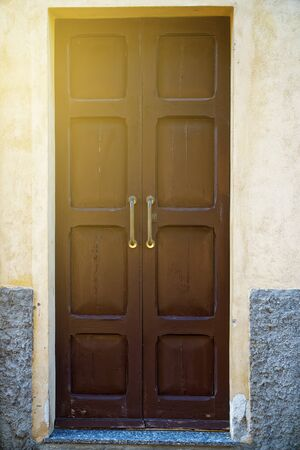 Door in brown vintage color, old wooden vintage surface , Italy culture. 写真素材