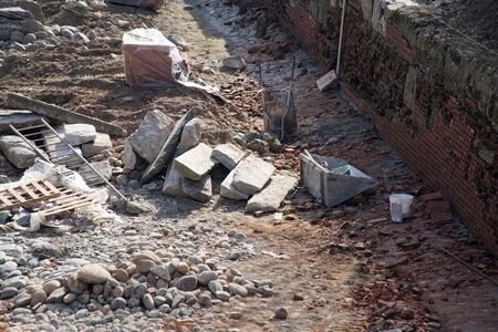 Construction Site damaged wall repairing, construction machinery, bulldozer, excavation factory 報道画像