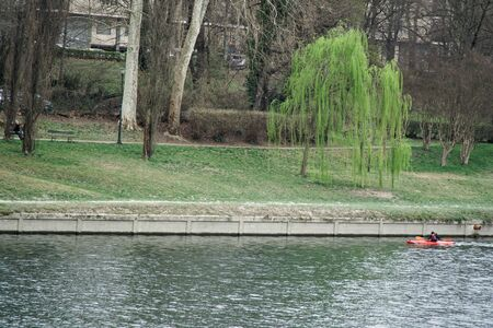 Torino, Italy, 17.03.2019: Man swims on a kayak on the river