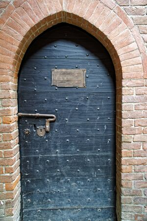 Medieval door with nameplate as template or mock-up