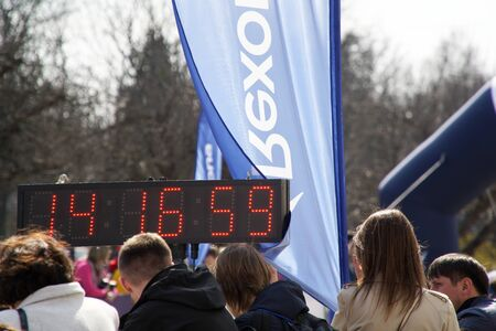 Kyiv - Ukraine, April 07, 2019: Face time of matathon. Crowd of People and Athletes Runners Run along the Road in the City. City Marathon Race. Racers starting to run on the marathon day.