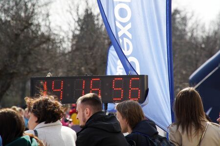 Kyiv-Ukraine, April 07, 2019: Face time of matathon. Crowd of People and Athletes Runners Run along the Road in the City. City Marathon Race. Racers starting to run on the marathon day. 報道画像