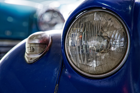 Headlight of antique old car, detail on the headlight of a vintage car. Selective focus.
