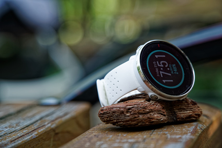 Close-up sport watch for running white color on wooden bench. Fitness watch for tracking daily activity and power training