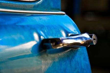 Edge door of car Door handle of retro classic car, Vintage tone. 写真素材