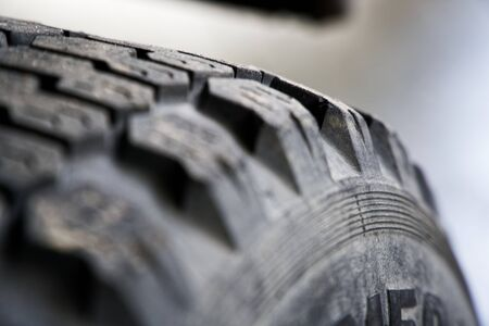 Car tires from old track, selective focus, close-up rough surface.