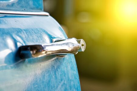 Edge door of car Door handle of retro classic car, Vintage tone. 스톡 콘텐츠