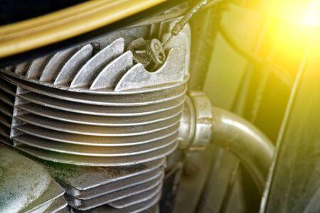 Old motorcycle motor engine in vintage photo.