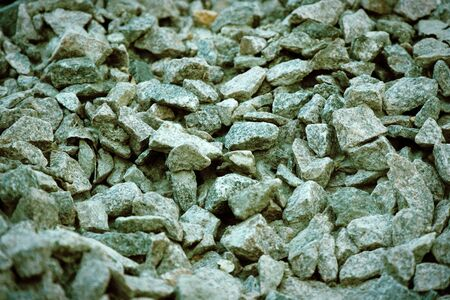 Road gravel and granite gravel texture. Crushed Gravel background. Pile of Stones texture. Industrial coals.