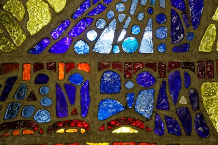 Glass mosaic from different pieces with colorful lights.