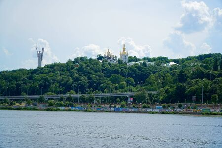 Kyiv cityscape with the Motherland Monument, Ukraine, view from Dnieper river.