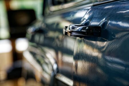 Edge door of car Door handle of retro classic car, Vintage tone. Reklamní fotografie