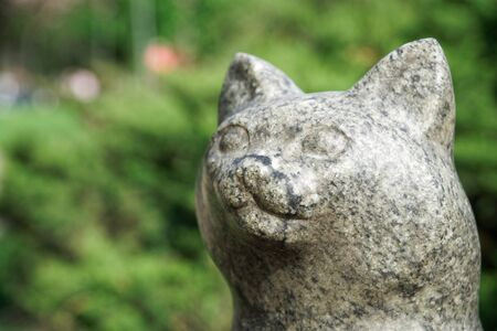 Cat statue from stone. Lucky rock cat head. Stock Photo