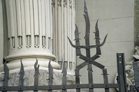 Weathered metal post finials Trident metal fence for protection against chimeras and evil power Stock Photo - 129012338